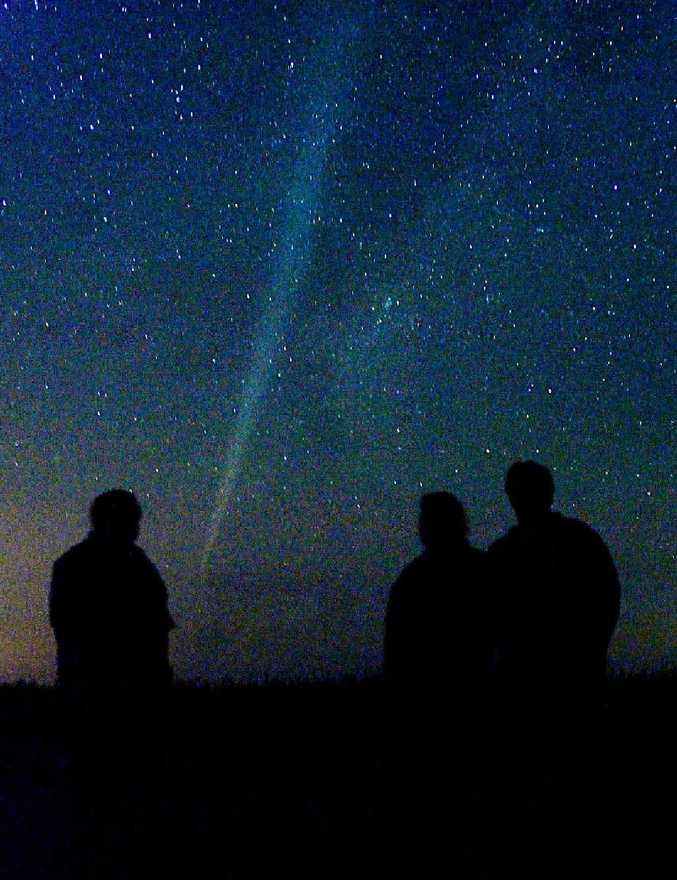 Mackay astronomy group Tropical Stargazers members Mick Benedetti, Josh Green and Warren Maag watch Comet Lovejoy in 2011.