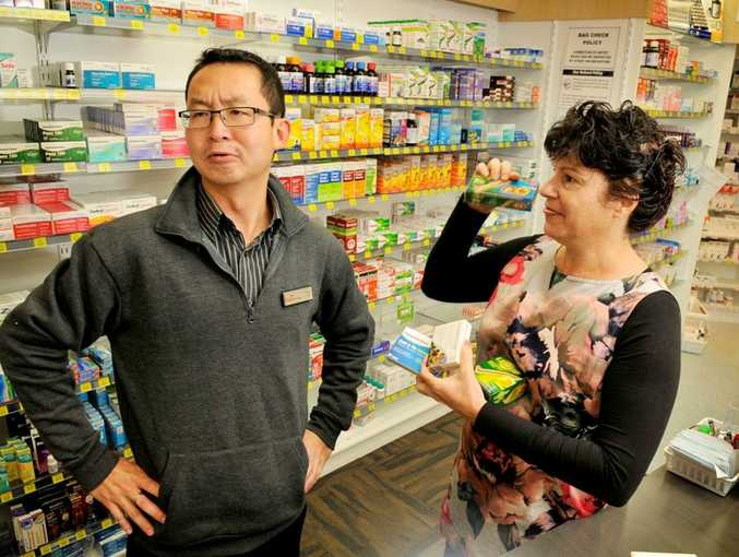 Pharmacist Fred Yeow and assistant Colleen Barham talk about man flu.
