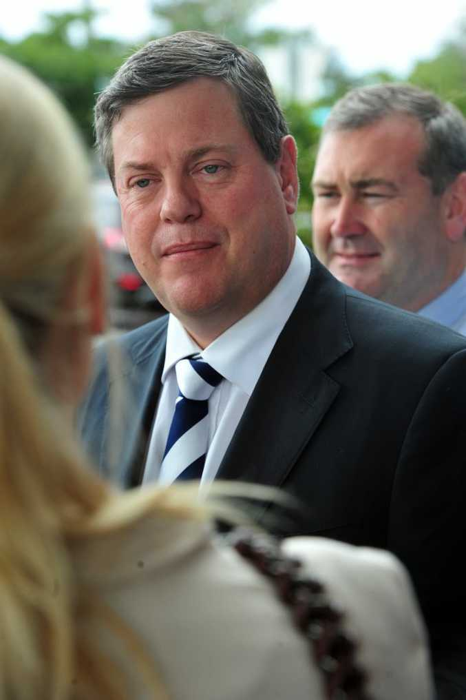 Queensland Treasurer Tim Nicholls talks to media before attending a luncheon held at The Waves.