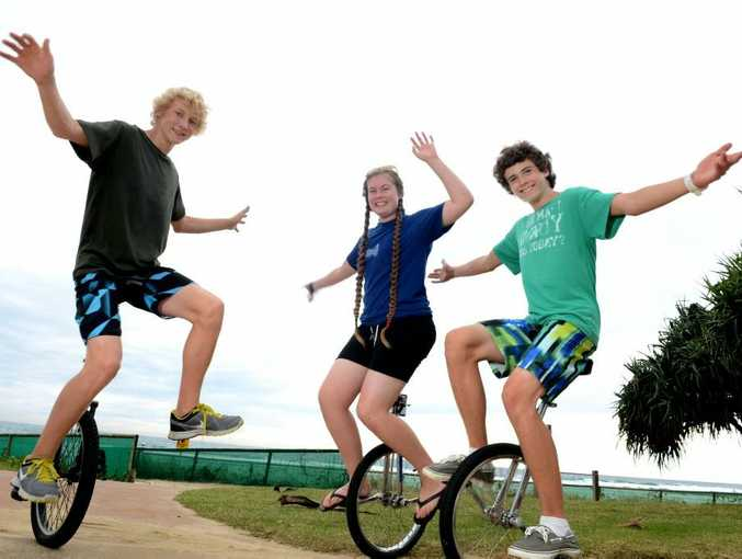 Charles Keidel, Rhiannon Fisher and Liam Fisher at rainbow beach on Uni cycles.