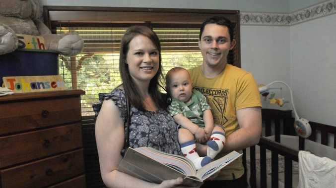 Medical student Tamara Johansen balances her seven-month-old son Seth and a demanding study schedule with support from her husband Jonathan.