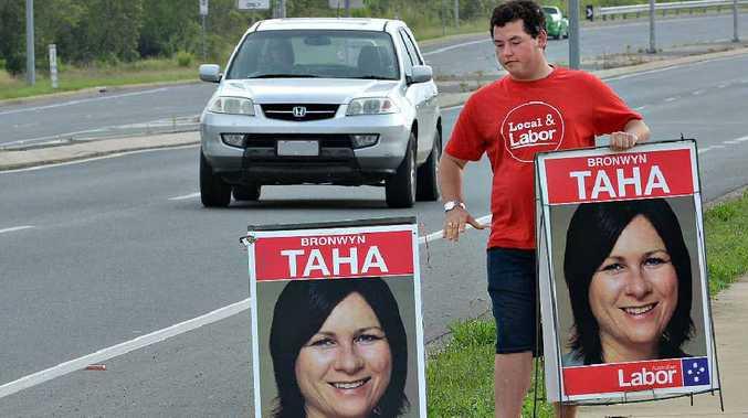 Cale Hutchins campaigns for Labor candidate for Dawson Bronwyn Taha on Barnes Creek Rd, North Mackay, yesterday.