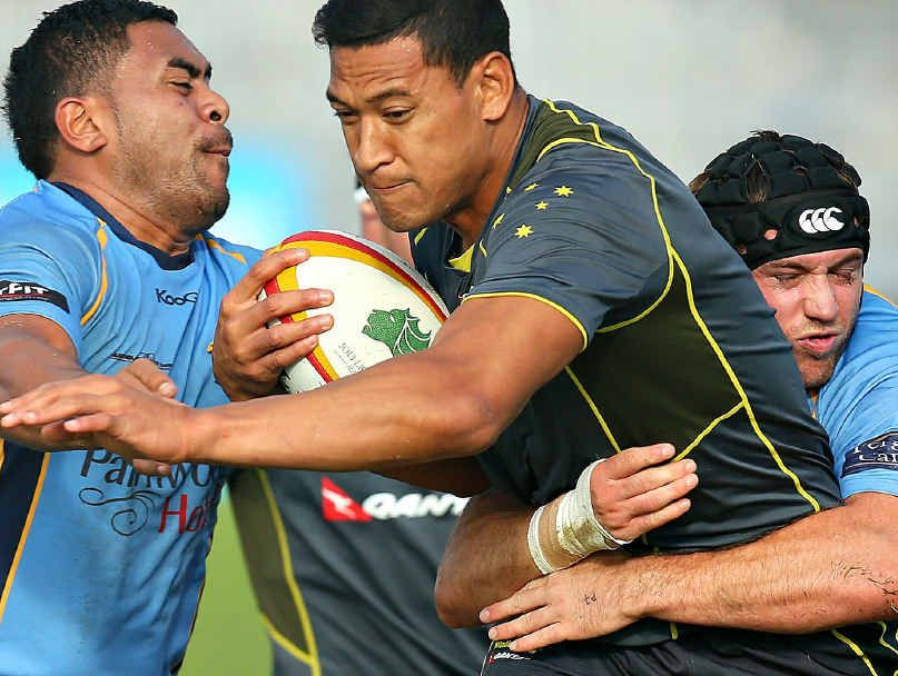 New Wallaby Israel Folau, centre, gets tackled by Stingrays Isaac Schwenke, left, and Tom Beattie during a training session on Tuesday.
