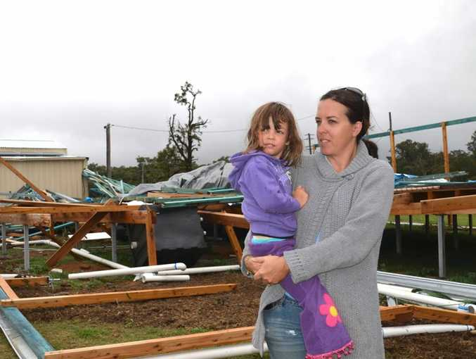 Pratten's Melissa Short and her daughter Ayla, 4, explore the aftermath of the storm that destroyed their home.