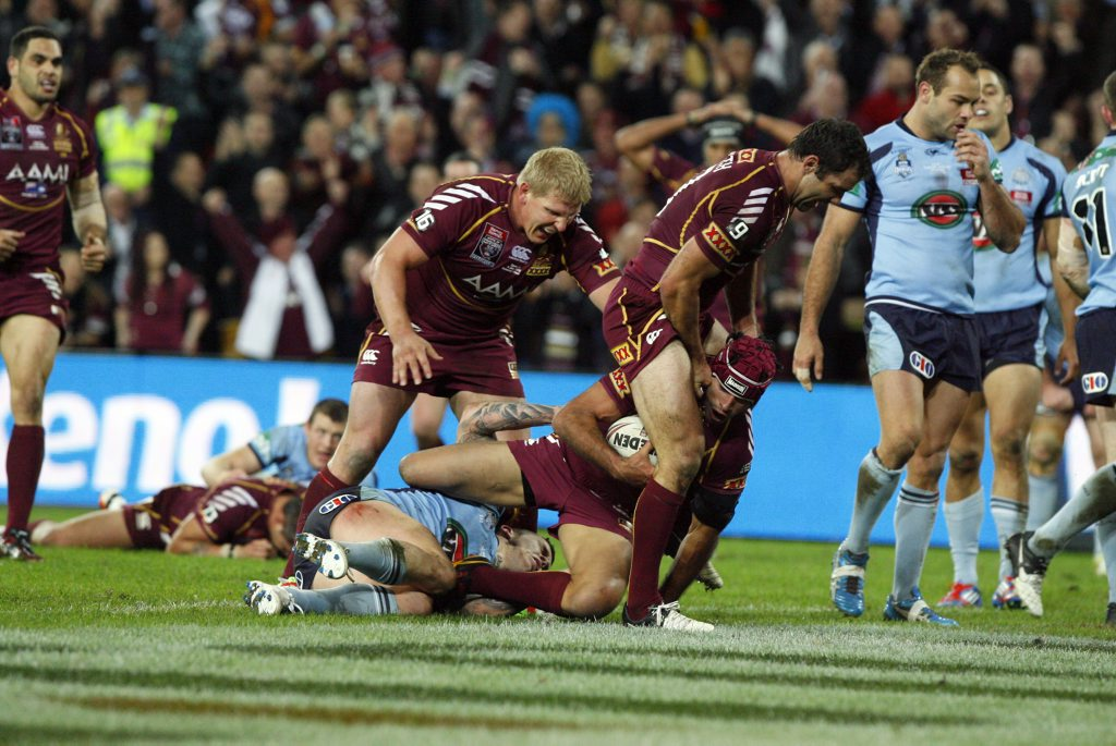 Johnathan Thurston is congratulated by Corey Parker and Ben Hannant after scoring Queensland's second try during the State of Origin decider game at Suncorp Stadium on Wednesday, June 4, 2012.