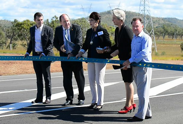 The moment Cr Margaret Strelow called for former mayor Brad Carter and former local member Robert Schwarten to help with cutting the ribbon of the new overpass. Photo: Sharyn O'Neill / The Morning Bulletin