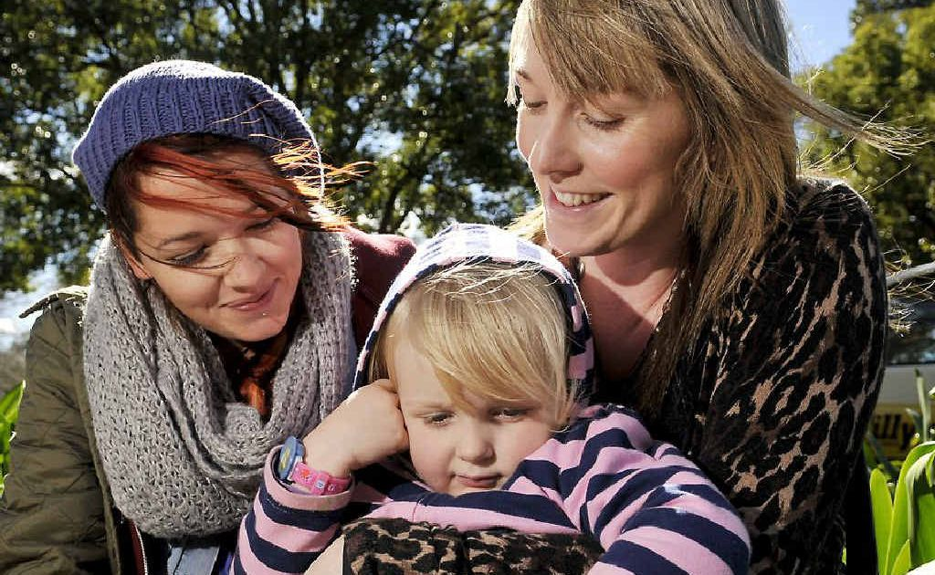 Enjoying a windy day outside are (from left) Chloe Carroll, Lindsey Brightwell and daughter Zoe Brightwell.