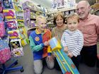 GRABBING A BARGAIN: Robyn Palmer from Toy World, Sandy and Jim Roberts from Alstonville with grandson Sam Green with a new broom set to help nan around the house at the Lismore stocktake sale on Saturday.