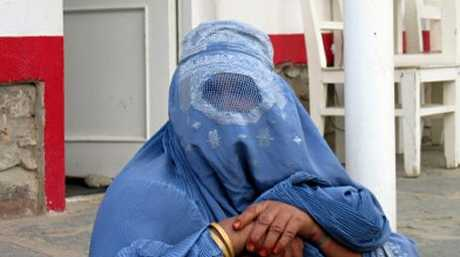 A woman wearing a traditional burqa