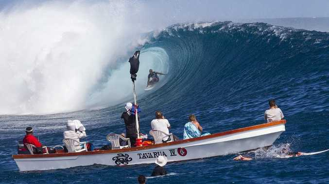 Kelly Slater on one of his 10 point rides winning the Volcom Fiji Pro at Cloudbreak, Tavarua, Fiji