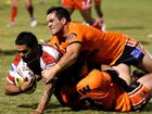 Norths Andrew Pannowitz is tackled by Wests' Jason Schirnack and Ben Hunter at Tiger Park on Saturday. Wests won 42-20.