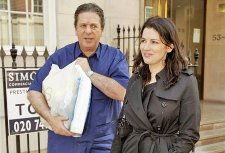 Nigella Lawson and her husband Charles Saatchi pictured in 2010