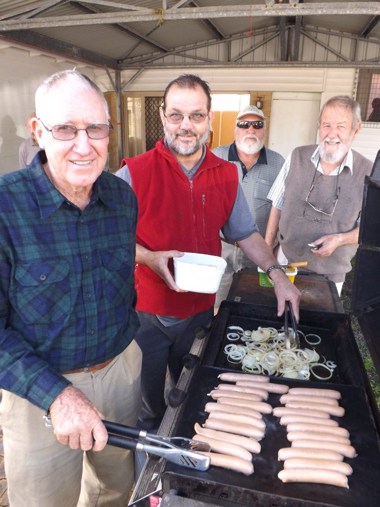 Cooking at the barbecue at the Ballina Community Men's Shed open day were Neville Foster, Michael Green, Geoff Haylor and Cedric Stedman. Photo Rebecca Lollback / The Northern Star