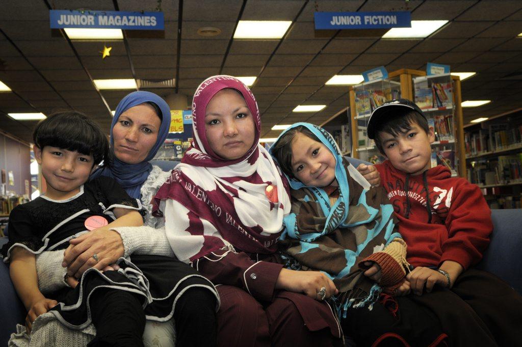 Wazir Begum Sultan comforts her children Shagufa, 8, Masooma Husaini, 18, Madina, 10 and Talib, 12.