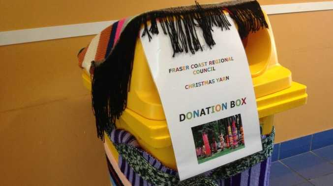 A donation bin outside the Hervey Bay Library for the Fraser Coast Regional Council's yarn bombing campaign.