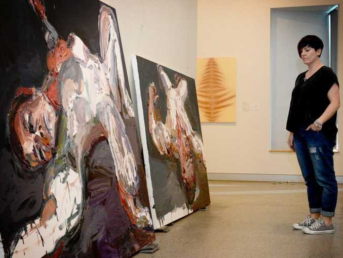 Laura Webster checks out a few of Ben Quilty's painting's.