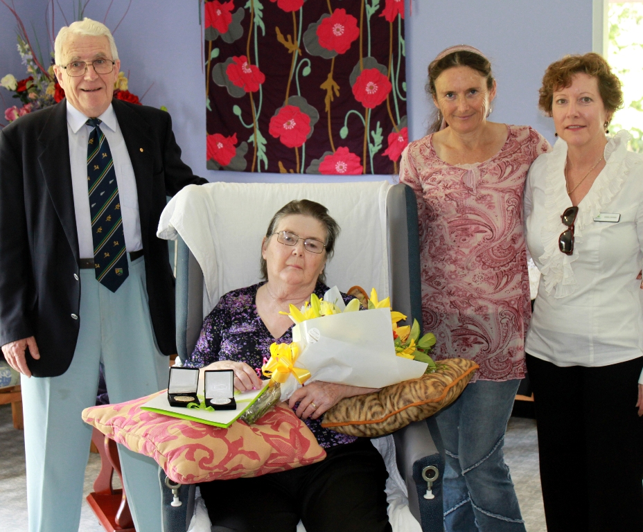 Win McCarter is congratulated by scheme administrator Dr Alan Stocks, her daughter Susanna Isaiah (second left) and Debra Lostroh.