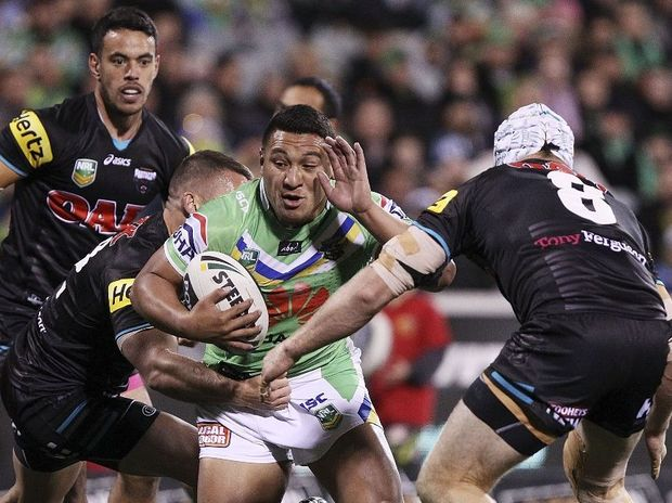 Josh Papalii of the Raiders is tackled during the round 14 NRL match between the Canberra Raiders and the Penrith Panthers at Canberra Stadium on June 15, 2013 in Canberra, Australia.
