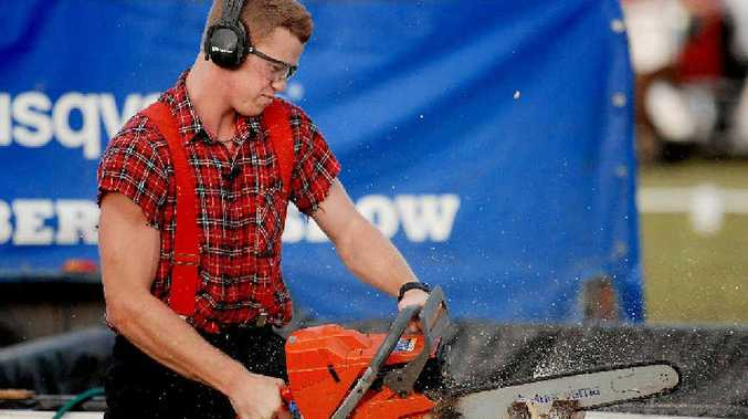 Stirling Hart from The Lumberjack Show saws through a wood block at the Mackay show.