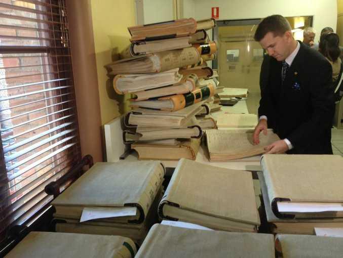 Queensland Attorney General Jarrod Bleijie looks through historic records progressively being put online.