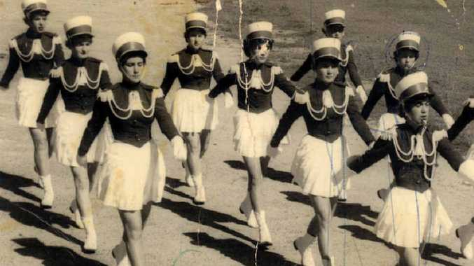 The Mackay City Chevrons Marching Band in action in Mackay, probably in the 1950s.