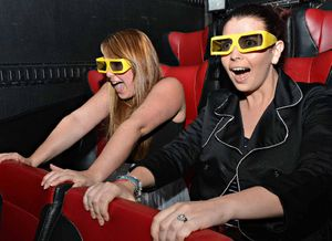 Daily Mercury reporters Kim Waters (left) and Letitia Commerford in the 9D cinema.
