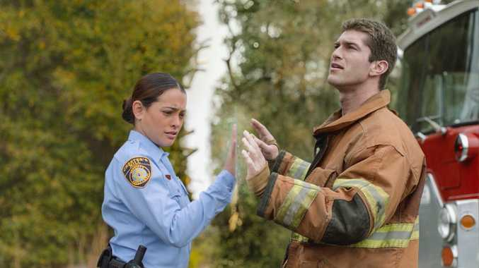 Natalie Martinez and Josh Carter pictured in a scene from the TV series Under the Dome.