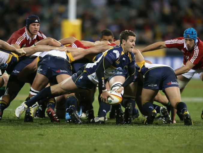 Ian Prior of the Brumbies passes the ball during the International tour match between the ACT Brumbies and the British & Irish Lions at Canberra Stadium on June 18, 2013 in Canberra, Australia.