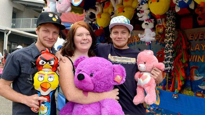 Cody Toon, Tessa Paul and Kris Toon with prizes and showbag goodies at the Mackay Show.