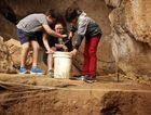 Blair and Tyler White explore a cave with Niki Outridge at The Capricorn Caves. You can too during the school holidays with a new interactive tour.