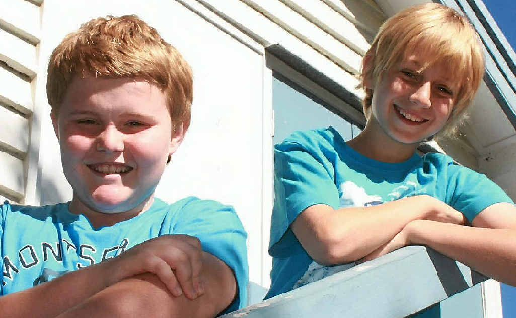 Joel Truelson, 12, and Noah Curtis, 11, will hold a Blue Dress Day at Bouldercombe State School today, raising money to fight Motor Neurone Disease.