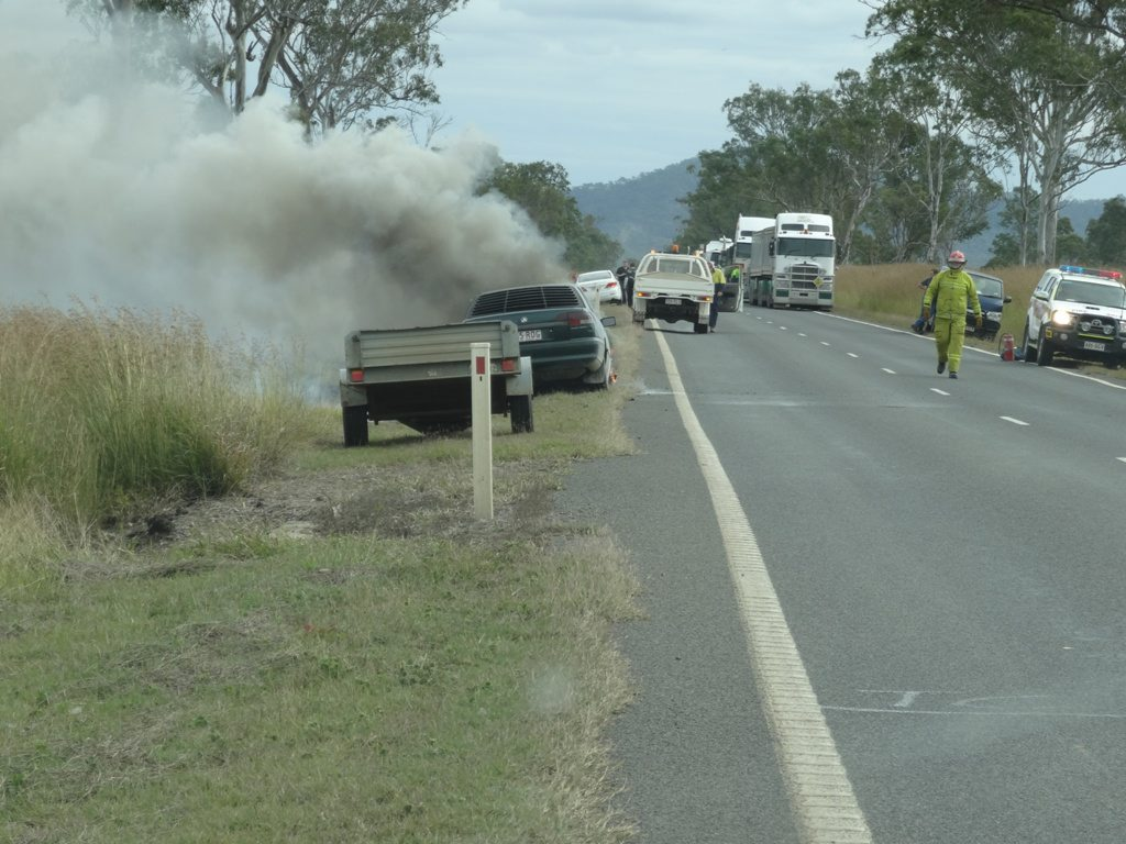 CAR FIRE: A family escaped without injury after a Holden Commodore caught on fire on the Dawson Hwy near Mt Alma.