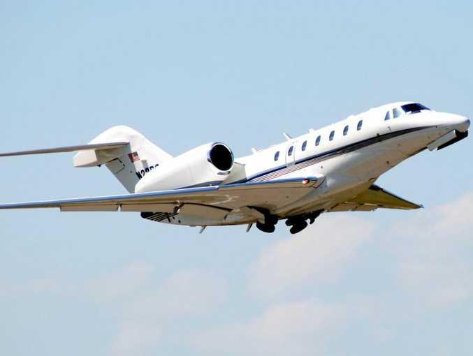 A Citation X corporate business jet in flight