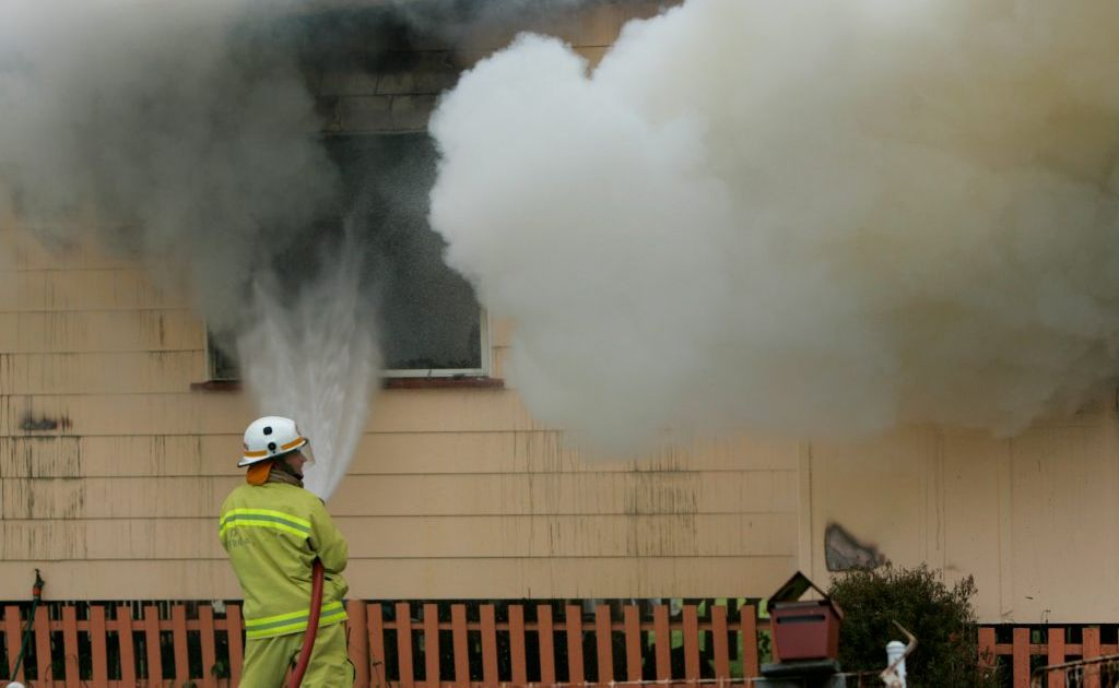 Fire fighters work to extinguish a house fire on Rockonia Road, Rockhampton. Photo: Chris Ison / The Morning Bulletin