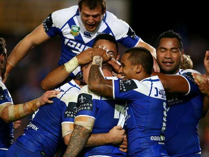 The Bulldogs celebrate a penalty goal by Trent Hodkinson in extra time to win the round 14 NRL match between the Manly Sea Eagles and the Canterbury Bulldogs at Brookvale Oval on June 14, 2013 in Sydney, Australia.