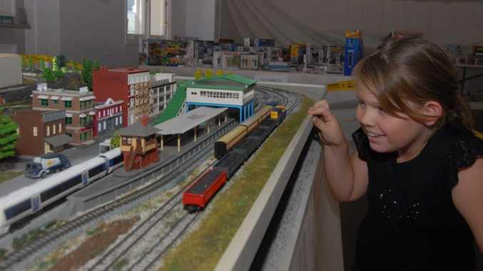 Ciana McKenzie with Ross Moore's railway model Photo Tony Martin / Daily Mercury