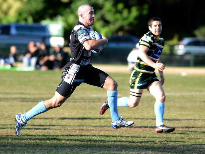 Tom Merritt about to run away for a long range try. Photo: Blainey Woodham / Daily News