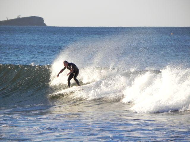 Surfing off Alexandra Headland.