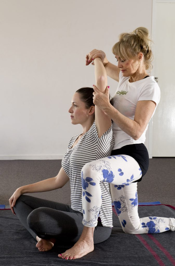 Deb Goulding demonstrates Thai Yoga with Laura Hunt. Photo Nev Madsen / The Chronicle