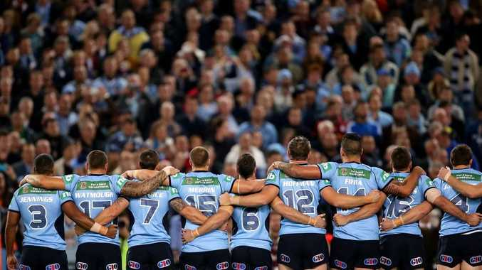 The Blues lineup and sing the national anthem before game one of the ARL State of Origin series between the New South Wales Blues and the Queensland Maroons at ANZ Stadium on June 5, 2013 in Sydney, Australia.