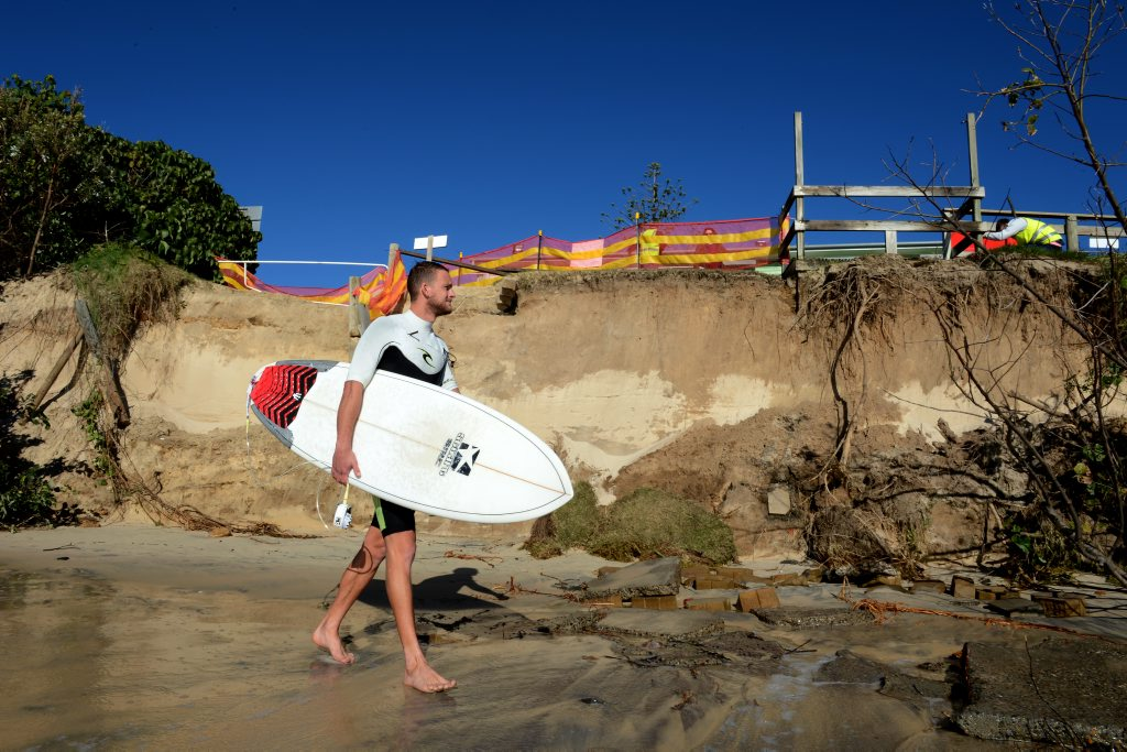 Ben Newman is going for a surf on his holiday at Fingal beach