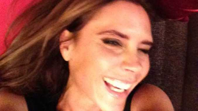 Facebook photo of Victoria Beckham smiling.