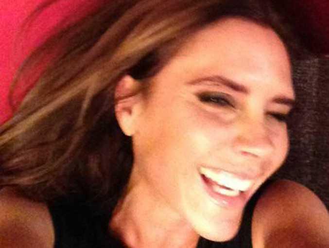 Facebook photo of Victoria Beckham smiling.