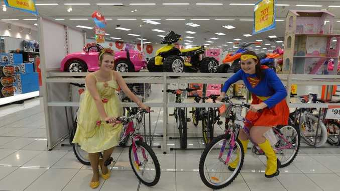 Target staff Imogen Dillon and Rebekah Wilhelmi are gearing up for their giant toy sale which starts today.