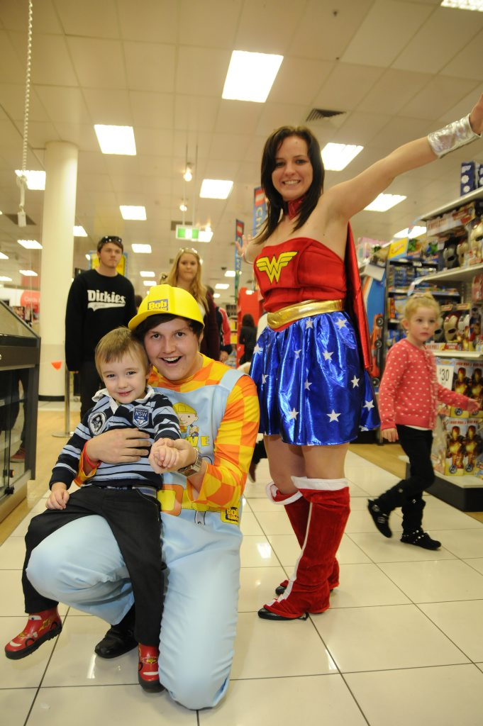 Kelly Duke as Bob the Builder joins Phoebe Warneke aka Wonder Woman and four-year-old Nathaniel Bess at Target toy sale yesterday.