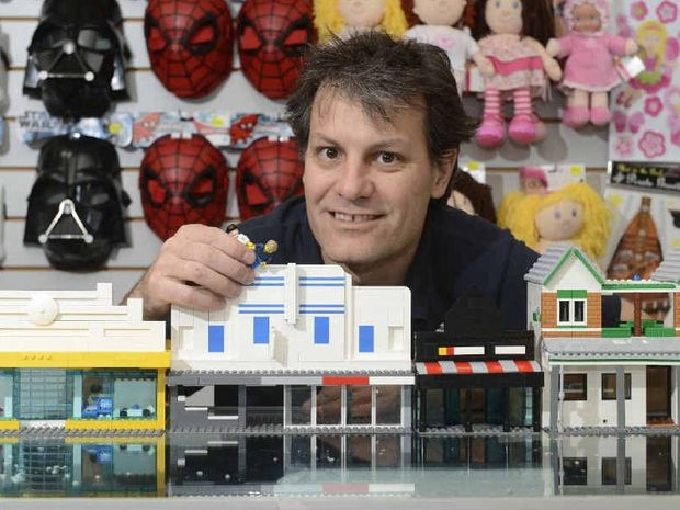 BLOCK AT A TIME: Boyd Moore from Toyworld Maclean with some of the Lego constructions of the main street by Brendan James. Photo: Adam Hourigan