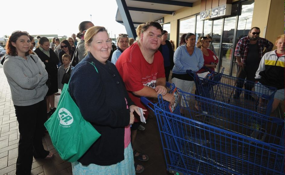 Shoppers line up outside Big W in Pialba waiting for the doors to open on the Big W giant toy spectacular. Joan Rogers and partner Gavin Dunn were one of the first to arrive at 7:30am and Joan was hoping to grab some bargains for her neice's baby.