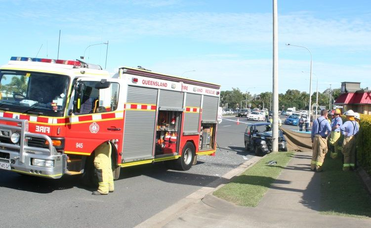 Emergency services at the scene of a fatal crash on Musgrave St, outside Amart Sports, at lunchtime today.