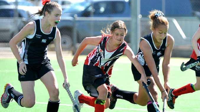 Mackay 1's Breanna Kerr, Rockhampton's Ebonee Moffat and Mackay's Jaleah George in full flight in a game at the under 13 girls state championships. Mackay won 3-0.