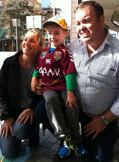 Patrick O'Sullivan with his mother and father as they leave the Mater Hospital to make their way back to Toowoomba.